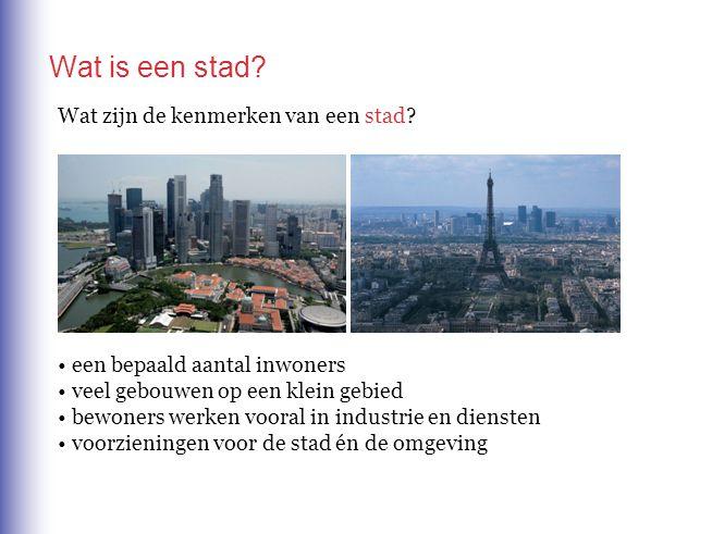 Wat is een stad? Wat zijn de kenmerken van een stad? een bepaald aantal inwoners veel gebouwen op een klein gebied bewoners werken vooral in industrie
