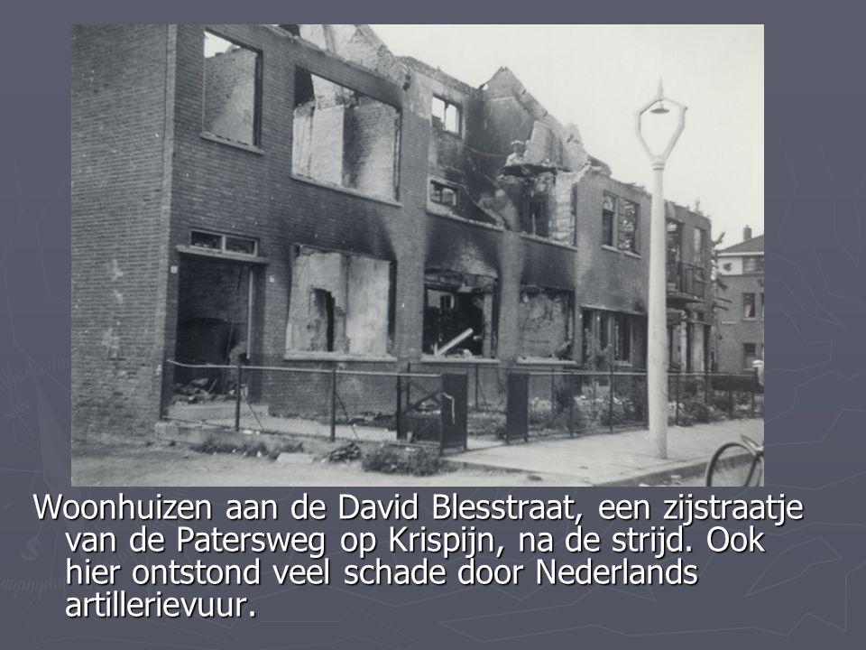 Woonhuizen aan de David Blesstraat, een zijstraatje van de Patersweg op Krispijn, na de strijd. Ook hier ontstond veel schade door Nederlands artiller