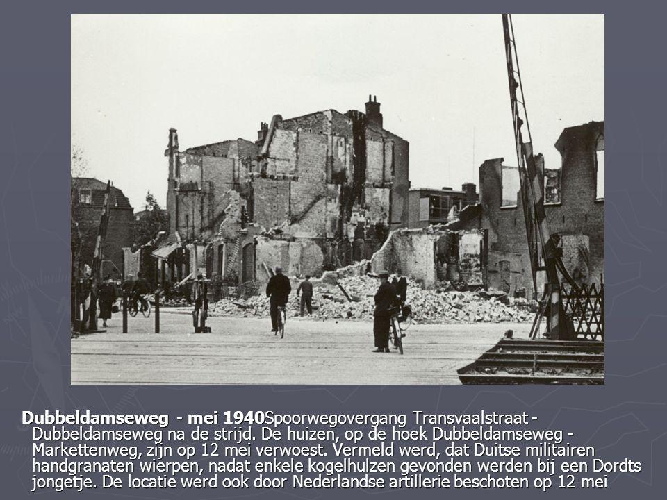 Dubbeldamseweg - mei 1940Spoorwegovergang Transvaalstraat - Dubbeldamseweg na de strijd. De huizen, op de hoek Dubbeldamseweg - Markettenweg, zijn op