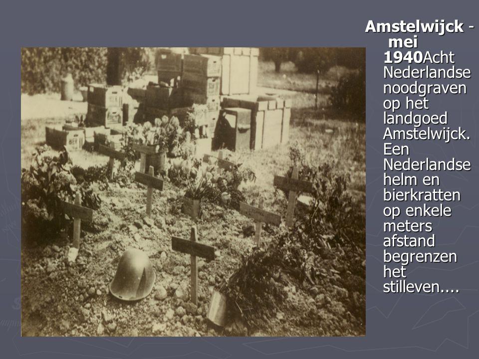 Amstelwijck - mei 1940Acht Nederlandse noodgraven op het landgoed Amstelwijck. Een Nederlandse helm en bierkratten op enkele meters afstand begrenzen