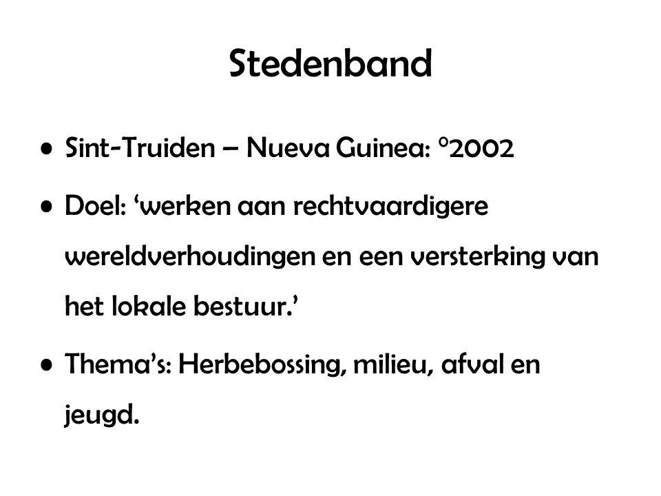 Stedenband Sint-Truiden – Nueva Guinea: °2002 Doel: 'werken aan rechtvaardigere wereldverhoudingen en een versterking van het lokale bestuur.' Thema's: Herbebossing, milieu, afval en jeugd.