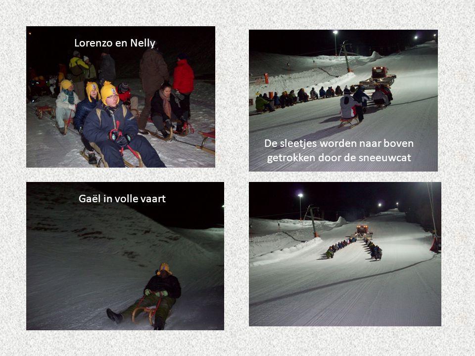 Lorenzo en Nelly De sleetjes worden naar boven getrokken door de sneeuwcat Gaël in volle vaart