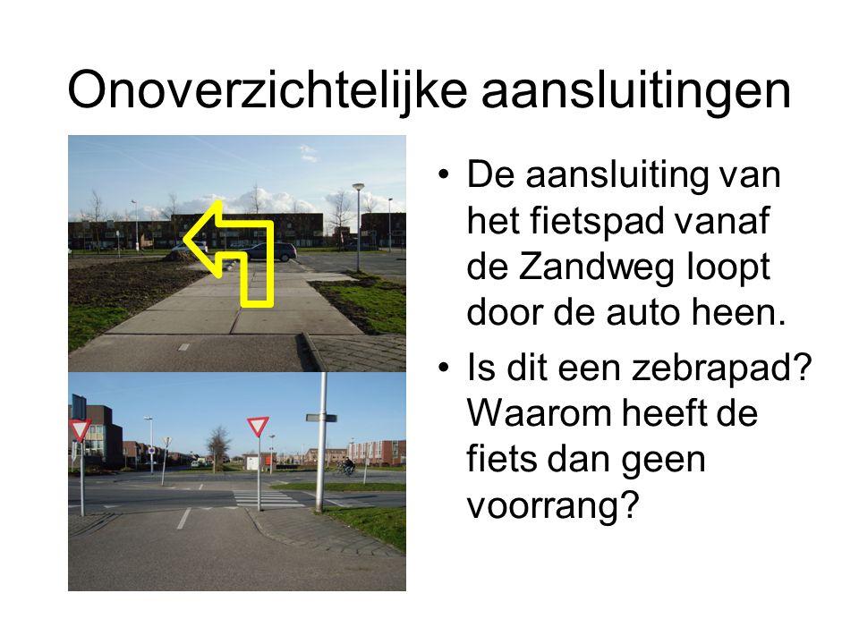 Onoverzichtelijke aansluitingen De aansluiting van het fietspad vanaf de Zandweg loopt door de auto heen. Is dit een zebrapad? Waarom heeft de fiets d