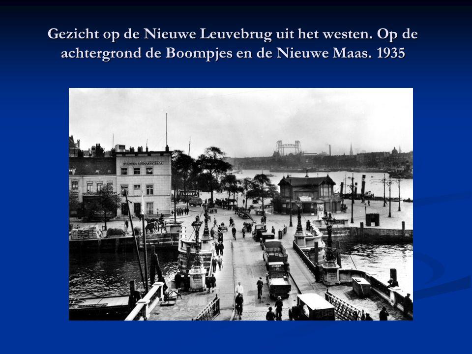 Gezicht op de Nieuwe Leuvebrug uit het westen. Op de achtergrond de Boompjes en de Nieuwe Maas. 1935