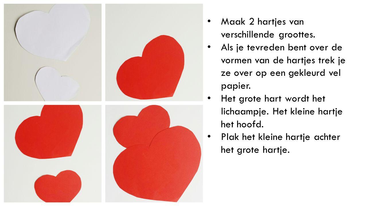 Maak 2 hartjes van verschillende groottes. Als je tevreden bent over de vormen van de hartjes trek je ze over op een gekleurd vel papier. Het grote ha