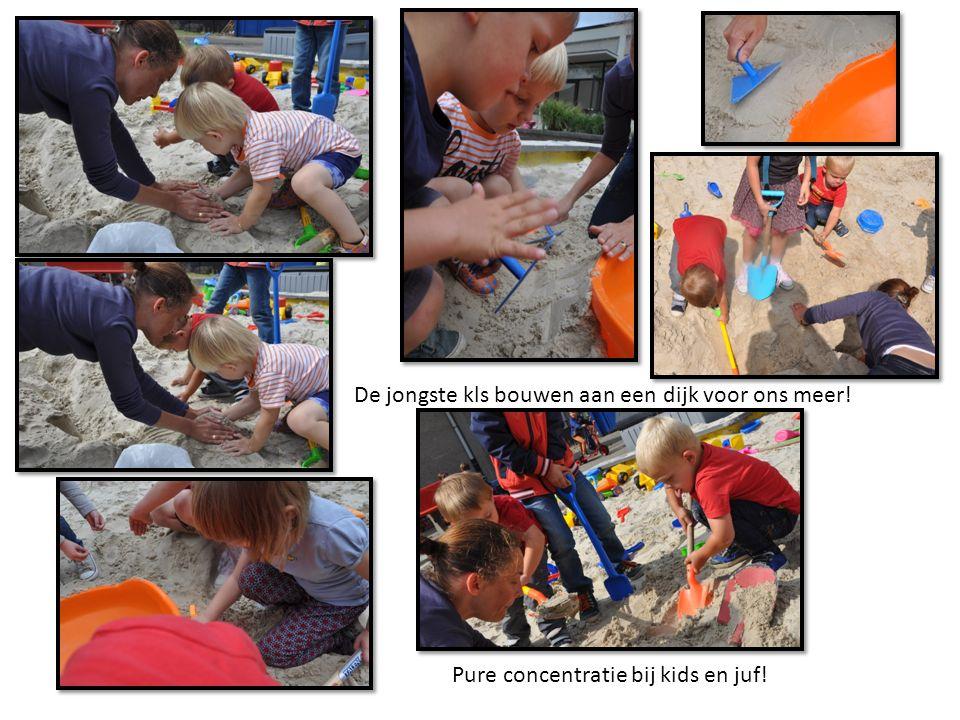 De jongste kls bouwen aan een dijk voor ons meer! Pure concentratie bij kids en juf!