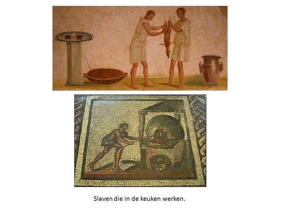 Slaven die in de keuken werken.