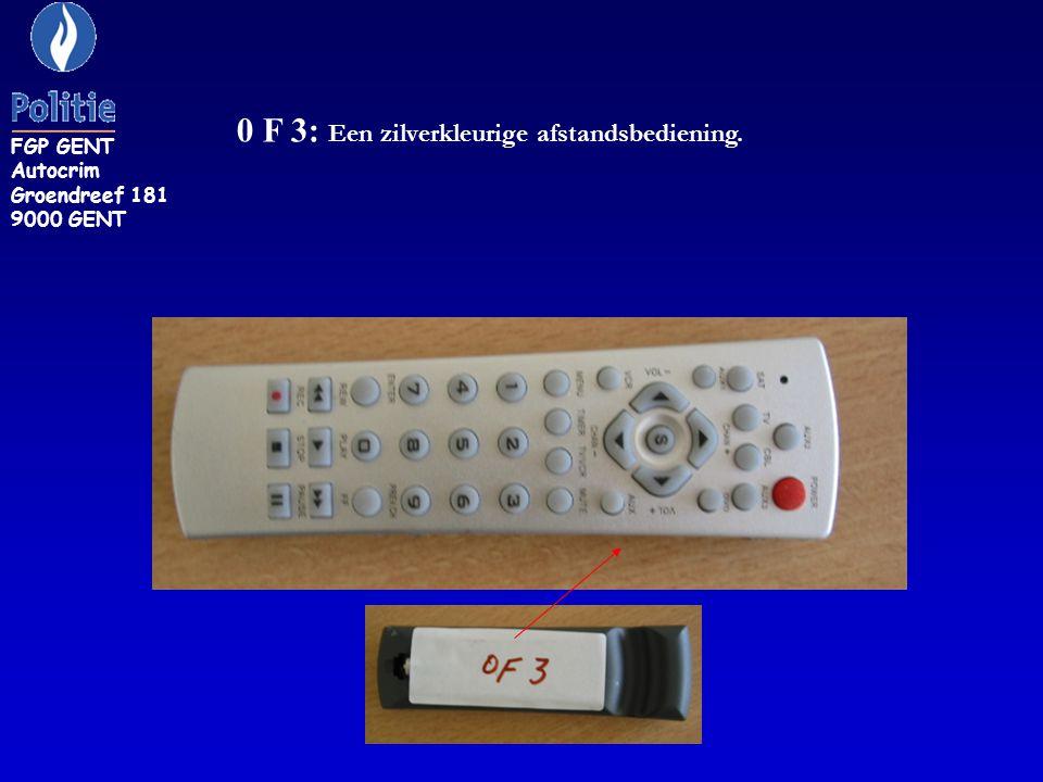 0 F 3: Een zilverkleurige afstandsbediening. FGP GENT Autocrim Groendreef 181 9000 GENT