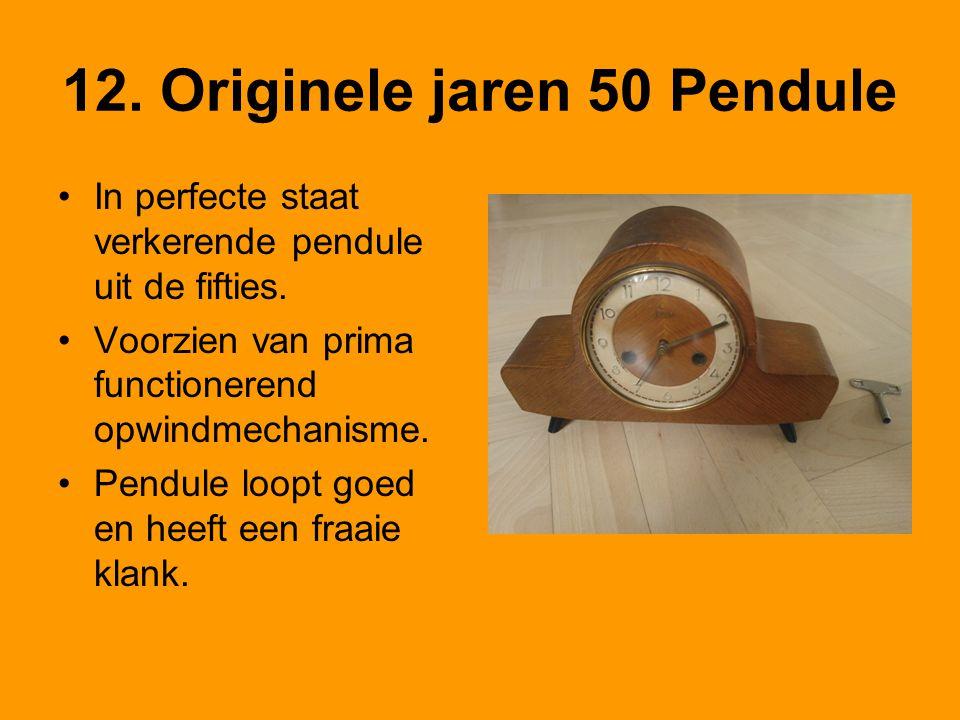 12. Originele jaren 50 Pendule •In perfecte staat verkerende pendule uit de fifties. •Voorzien van prima functionerend opwindmechanisme. •Pendule loop