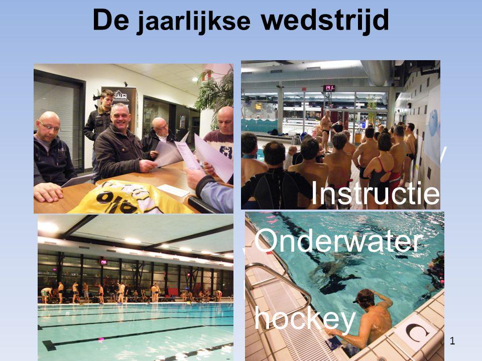 John is met de nodige voor- bereiding en jury uitleg bezig Voorbereiden bij het bad De jaarlijkse wedstrijd 1 Instructie Onderwater hockey