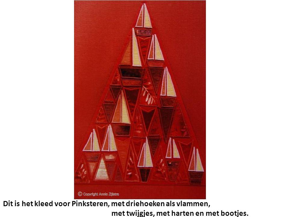 Dit is het kleed voor Pinksteren, met driehoeken als vlammen, met twijgjes, met harten en met bootjes.