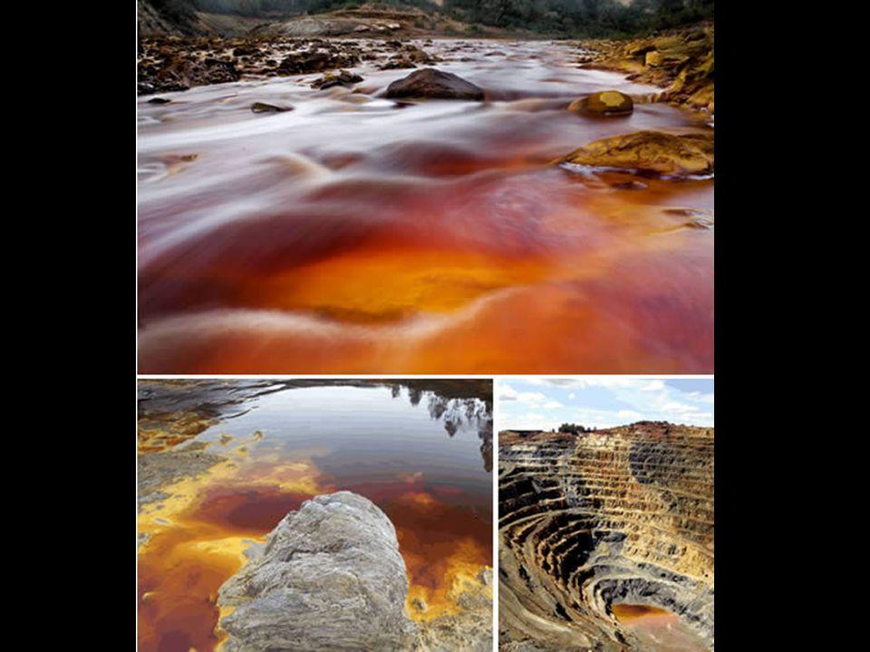 De grote mijnen langs de Rode Rivier scheppen een surrealistisch landschap. De uitbating ervan heeft complete bergen, valleien en dorpen opgeslorpt. H