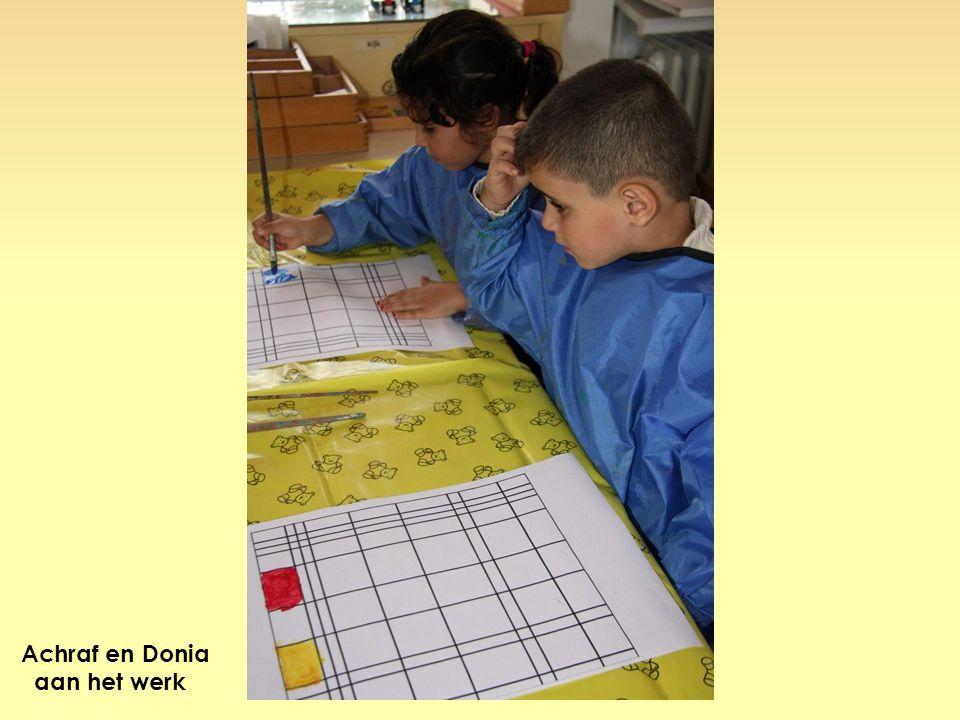Achraf en Donia aan het werk