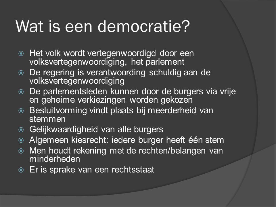 Wat is een democratie?  Het volk wordt vertegenwoordigd door een volksvertegenwoordiging, het parlement  De regering is verantwoording schuldig aan