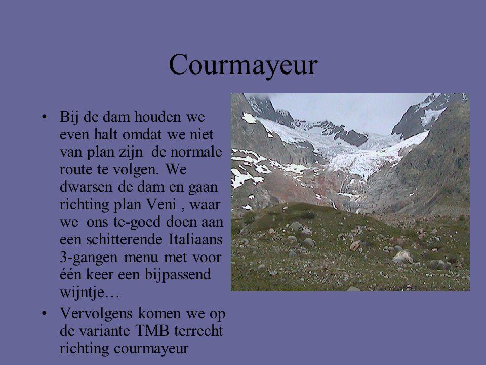 Courmayeur •Bij de dam houden we even halt omdat we niet van plan zijn de normale route te volgen. We dwarsen de dam en gaan richting plan Veni, waar