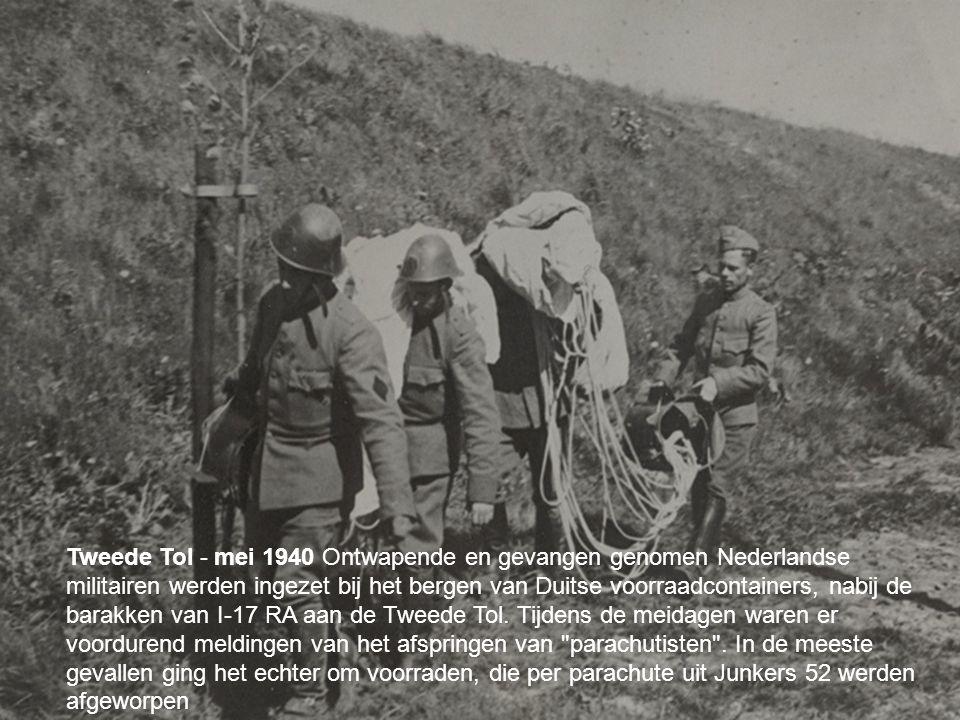 your name Tweede Tol - mei 1940 Ontwapende en gevangen genomen Nederlandse militairen werden ingezet bij het bergen van Duitse voorraadcontainers, nabij de barakken van I-17 RA aan de Tweede Tol.