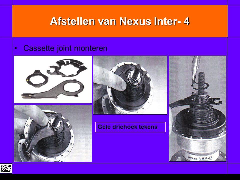 Afstellen van Nexus Inter- 4 •Cassette joint monteren Gele driehoek tekens