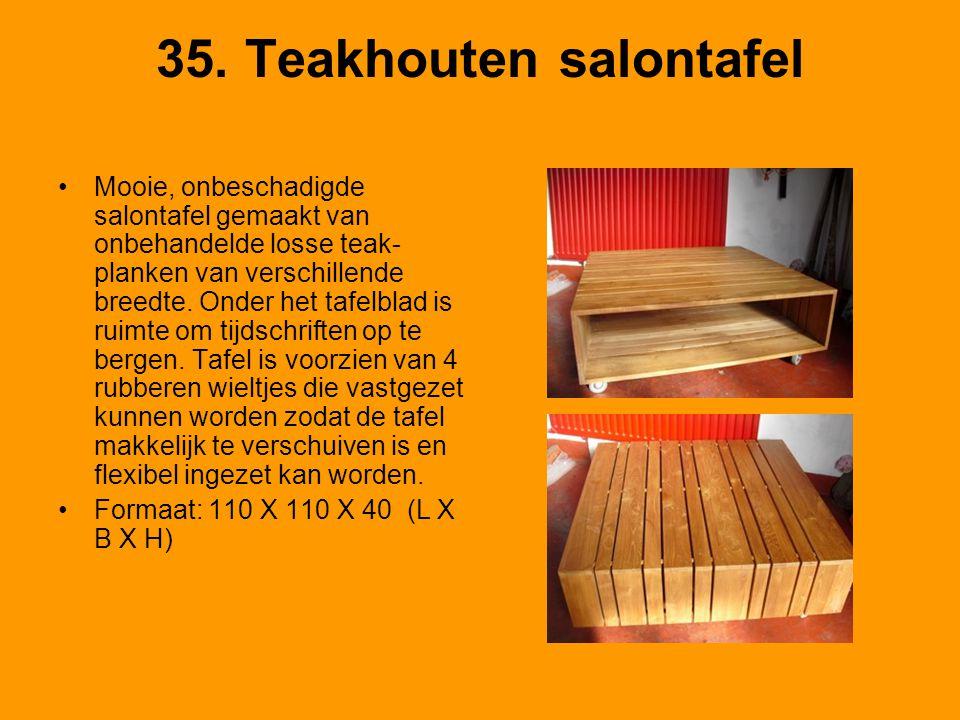 35. Teakhouten salontafel Mooie, onbeschadigde salontafel gemaakt van onbehandelde losse teak- planken van verschillende breedte. Onder het tafelblad