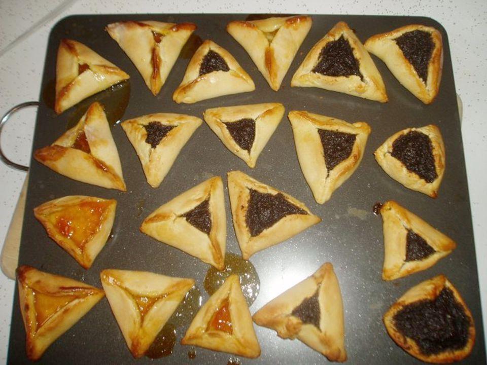 Purim Purim Feest in 2011 = 19-20 maart Soort Joods carnaval Gebruiken: –Hamen-taschen eten –4 dingen doen…