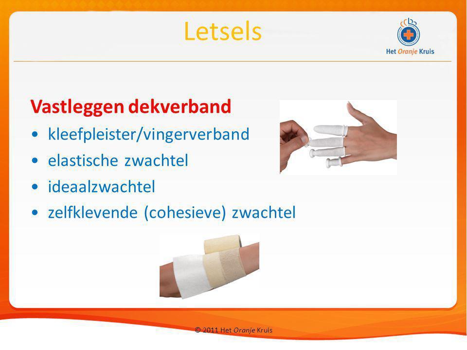 © 2011 Het Oranje Kruis Vastleggen dekverband kleefpleister/vingerverband elastische zwachtel ideaalzwachtel zelfklevende (cohesieve) zwachtel Letsels