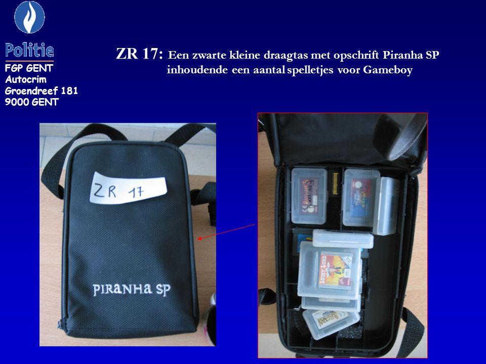 ZR 17: Een zwarte kleine draagtas met opschrift Piranha SP inhoudende een aantal spelletjes voor Gameboy FGP GENT Autocrim Groendreef 181 9000 GENT