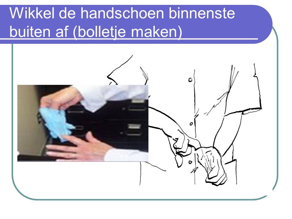 Wikkel de handschoen binnenste buiten af (bolletje maken)