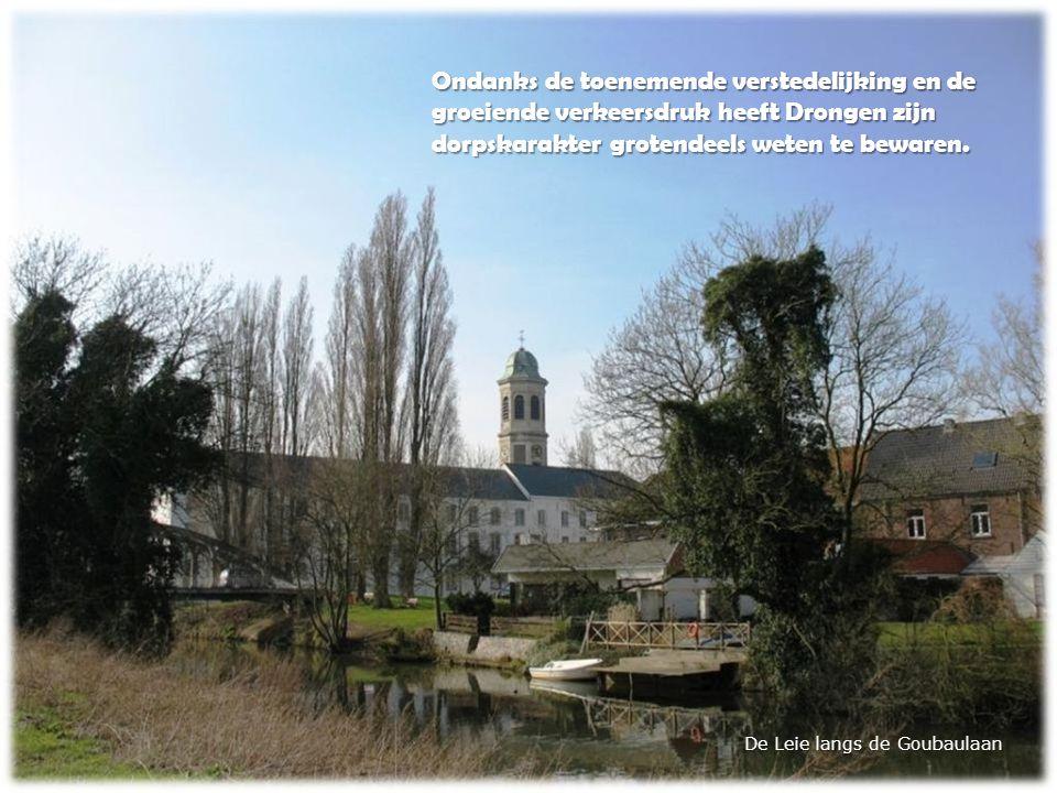 De Leie langs de Goubaulaan Ondanks de toenemende verstedelijking en de groeiende verkeersdruk heeft Drongen zijn dorpskarakter grotendeels weten te bewaren.