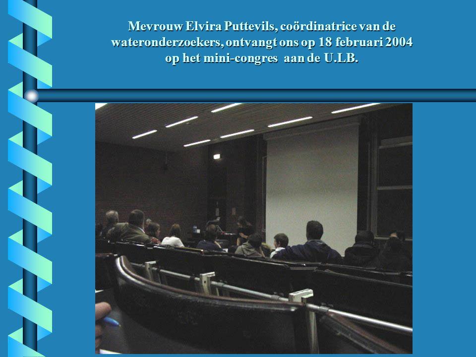 Mevrouw Elvira Puttevils, coördinatrice van de wateronderzoekers, ontvangt ons op 18 februari 2004 op het mini-congres aan de U.LB.