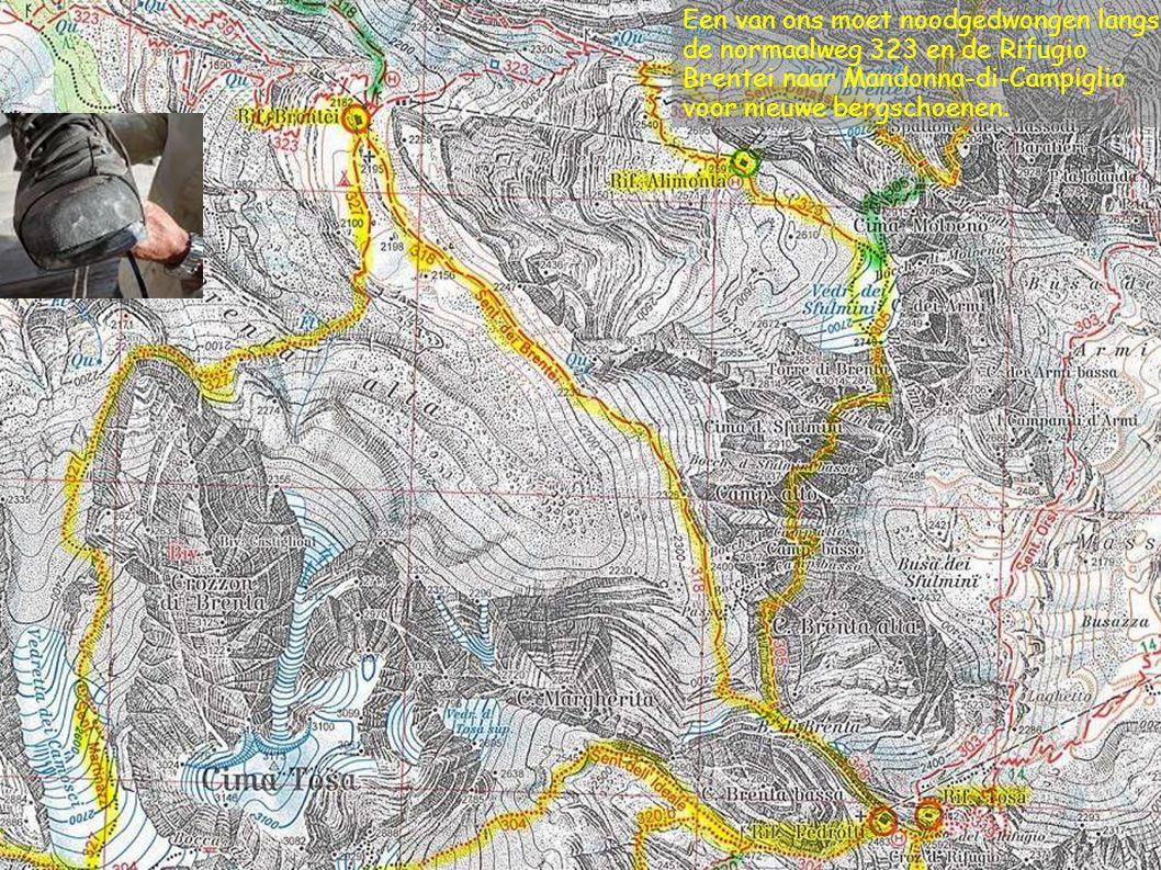 Een van ons moet noodgedwongen langs de normaalweg 323 en de Rifugio Brentei naar Mandonna-di-Campiglio voor nieuwe bergschoenen.