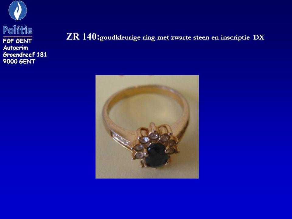 ZR 140: goudkleurige ring met zwarte steen en inscriptie DX FGP GENT Autocrim Groendreef 181 9000 GENT
