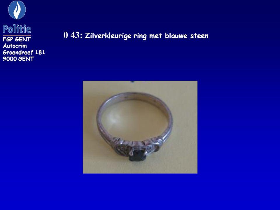 ZR 149: ring, metaalkleur, met groene en witte steen FGP GENT Autocrim Groendreef 181 9000 GENT