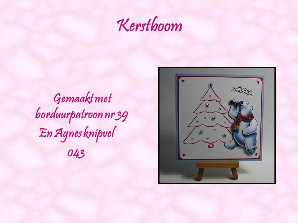 Roze roos in kruis Gemaakt met borduurpatroon nr 34 en Agnes knipvel 035