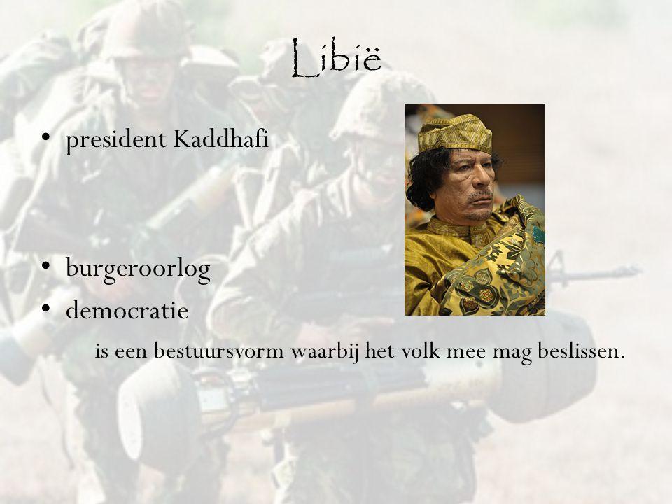 Libië president Kaddhafi burgeroorlog democratie is een bestuursvorm waarbij het volk mee mag beslissen.