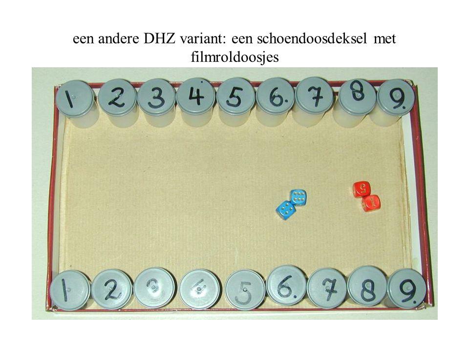 een andere DHZ variant: een schoendoosdeksel met filmroldoosjes