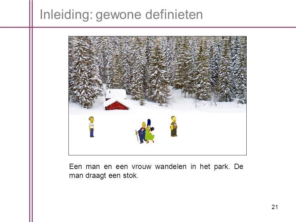 21 Inleiding: gewone definieten Een man en een vrouw wandelen in het park. De man draagt een stok.