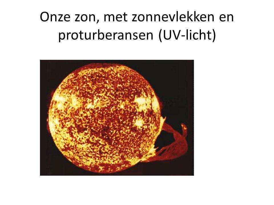 Onze zon, met zonnevlekken en proturberansen (UV-licht)