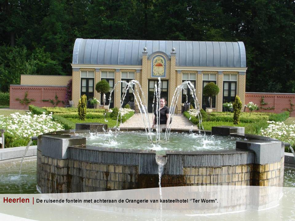 Heerlen | De ruisende fontein met achteraan de Orangerie van kasteelhotel ''Ter Worm''.