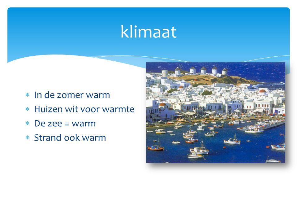 klimaat  In de zomer warm  Huizen wit voor warmte  De zee = warm  Strand ook warm