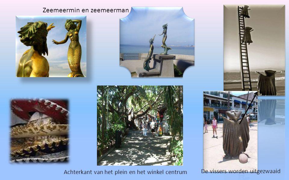 """""""Malecon"""" de boulevaer waar allemaal beelden staan die met de zee te maken hebben Jongen op zeepaart Dolvijnen dansen met op de achtergrond bogen die"""