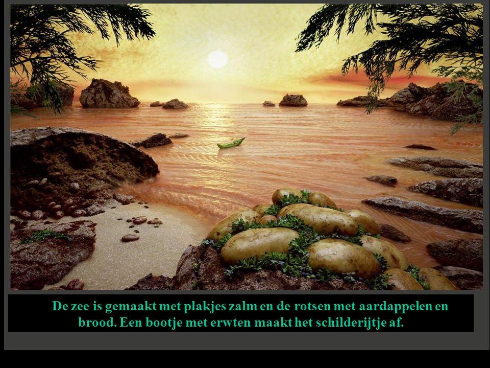 De zee is gemaakt met plakjes zalm en de rotsen met aardappelen en brood. Een bootje met erwten maakt het schilderijtje af.