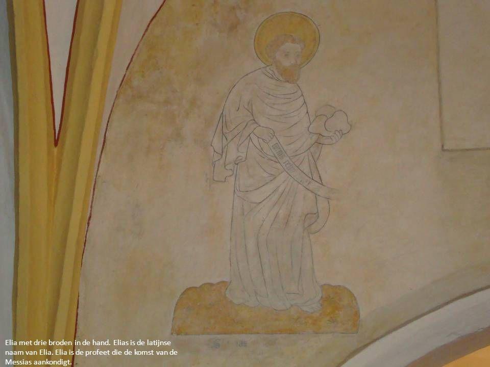 Elia met drie broden in de hand. Elias is de latijnse naam van Elia. Elia is de profeet die de komst van de Messias aankondigt.