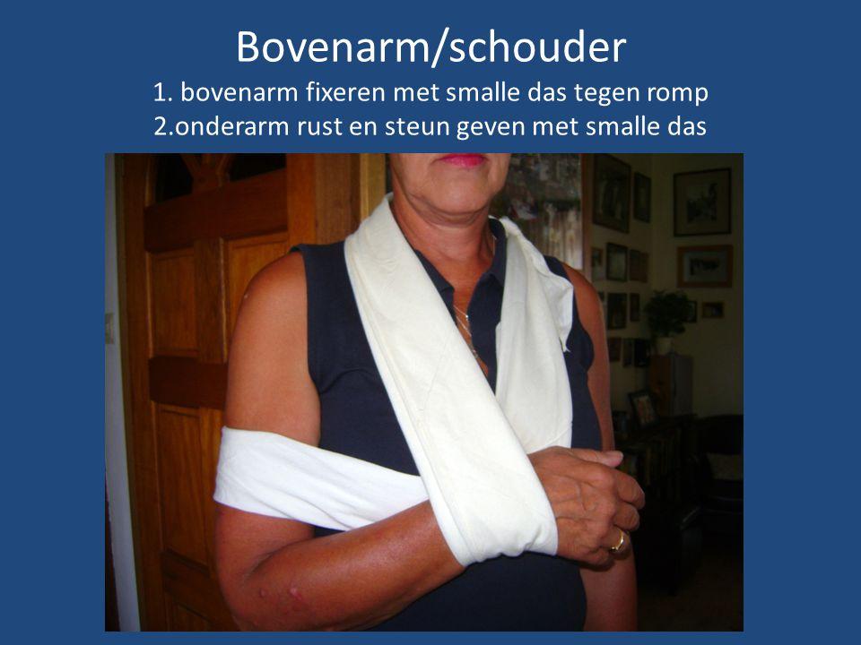 Bovenarm/schouder 1. bovenarm fixeren met smalle das tegen romp 2.onderarm rust en steun geven met smalle das